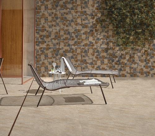 Gạch ốp tường mang họa tiết vân đá theo phong cách mosaic để chắn bớt ánh sáng trên khu sân thượng